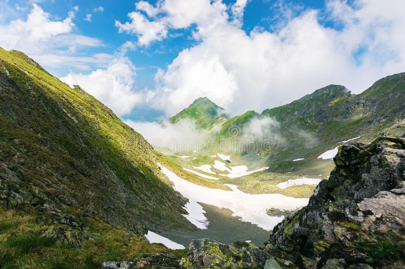 On the edge of rocky cliff of Fagaras valley royalty free stock photos