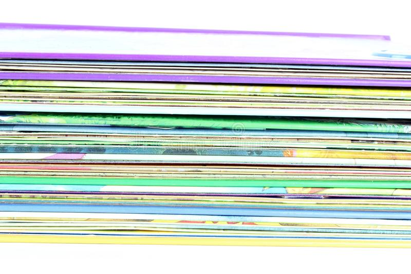 Edge of the stack of colored paper. For illustration, on white background stock photo