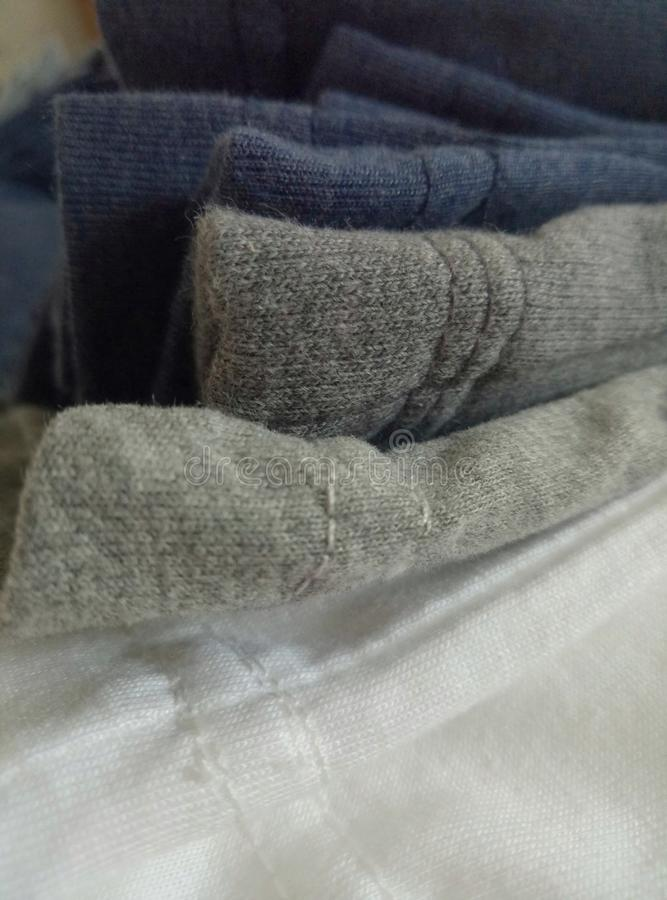 Edge stitching of several colorful cotton shirts royalty free stock image