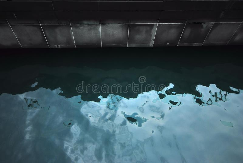 Edge of the water at a swimming pool stock images