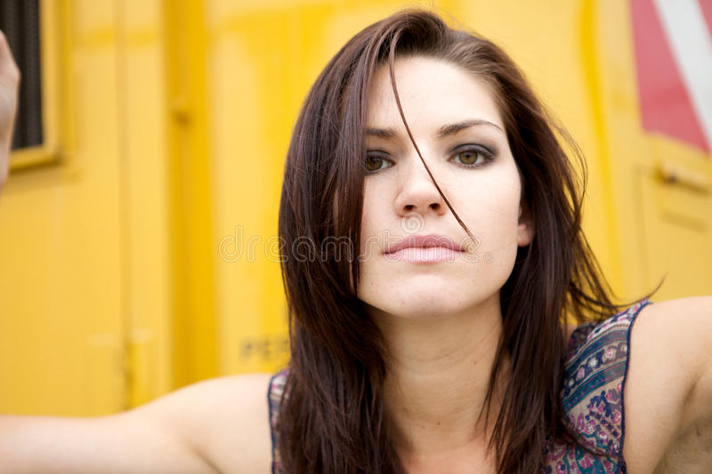 Edgy Girl With Yellow Backround Royalty Free Stock Photo
