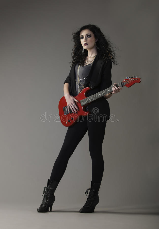 Edgy Rocker Woman Playing Red Guitar Stock Image - Image -4599
