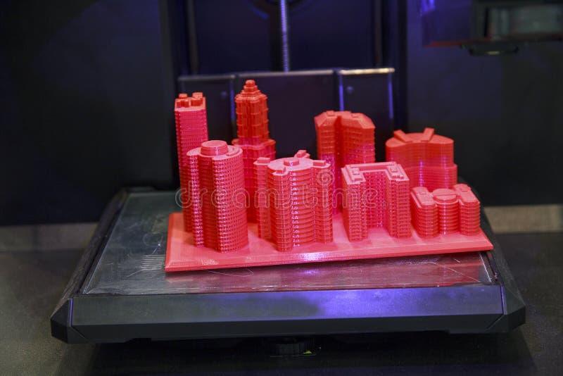 Edificio futurista de la disposición hecho por la impresión 3D imagenes de archivo