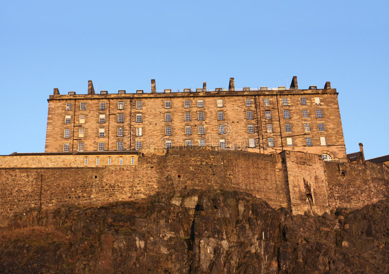 Edinburgh castle at dusk. Western facade of Edinburgh castle at dusk stock photos