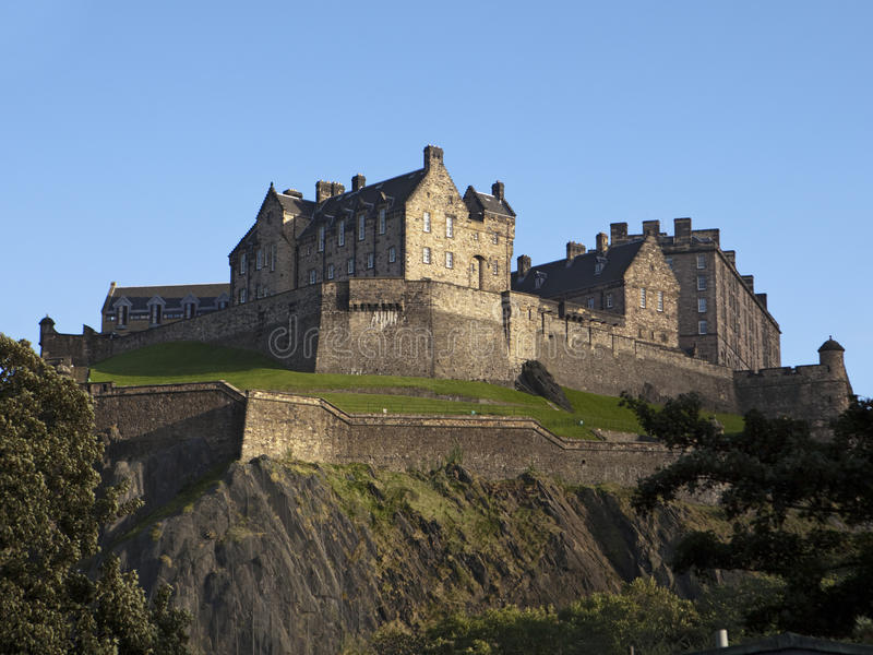Edinburgh Castle and Ramparts. A view of Edinburgh Castle from below showing the rocky cliffs, ramparts and other defenses from attack royalty free stock photography