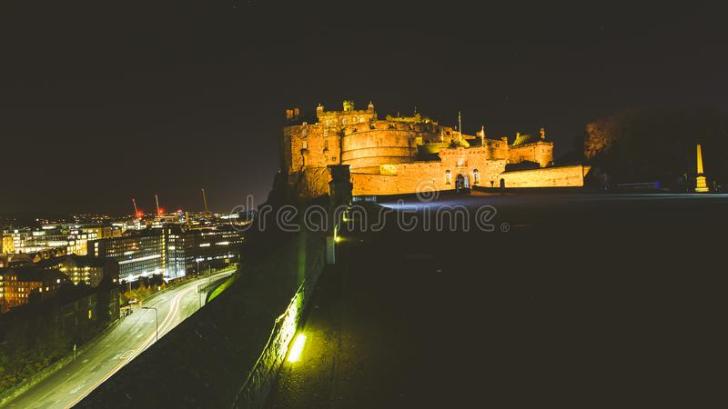 Edinburgh Castle with view of City in background by night royalty free stock image