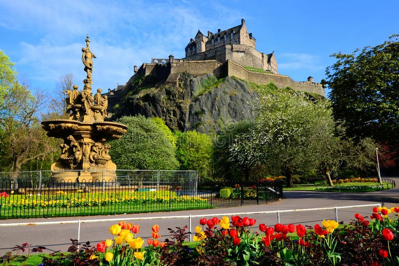 Edinburgh castle view. From Princes Street Gardens with fountain and flowers stock images