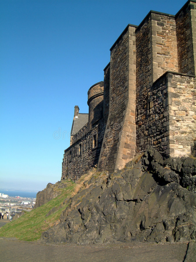 Edinburgh Castle walls. Stone walls at Edinburgh Castle, Scotland on a bright October day. The castle makes good use of the natural volcanic rock formation stock images