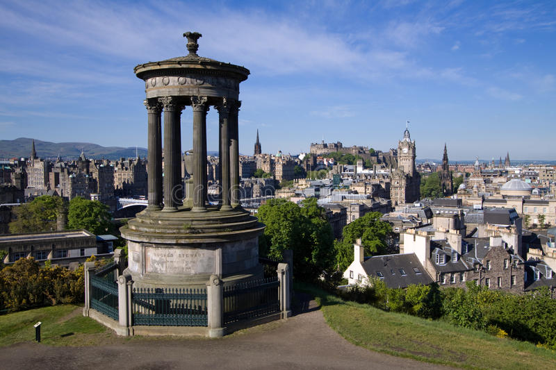 Edinburgh City And Castle From Calton Hill. Edinburgh City and Castle viewed from Calton Hill on a glorious mid-summer morning royalty free stock image