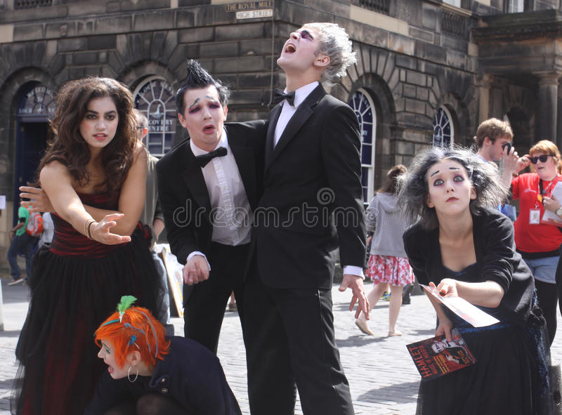 Edinburgh Fringe Festival 2011. EDINBURGH- AUGUST 14 2011: Members of Westminster Theatre Company publicize their show on Royal Mile during Edinburgh Fringe royalty free stock image