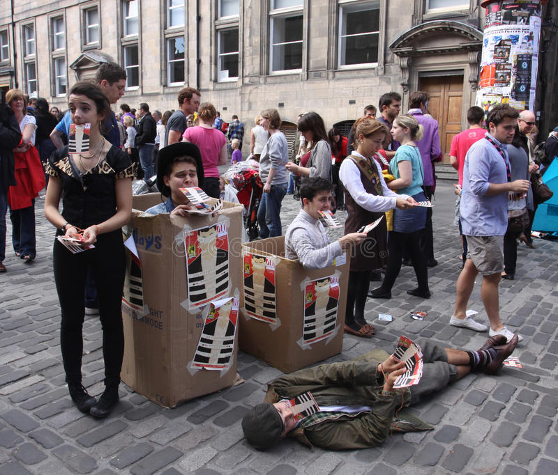 Edinburgh Fringe Festival 2011. EDINBURGH- AUGUST 14 2011: Members of Article19 publicize their show on Royal Mile during Edinburgh Fringe Festival on August 14 royalty free stock images
