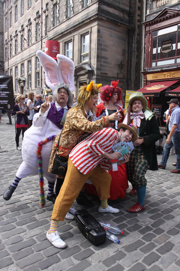 Edinburgh Fringe Festival 2011. EDINBURGH- AUGUST 14 2011: Members of TaleGate Theatre publicize their show Alice's Adventures in Wonderland during Edinburgh royalty free stock photos