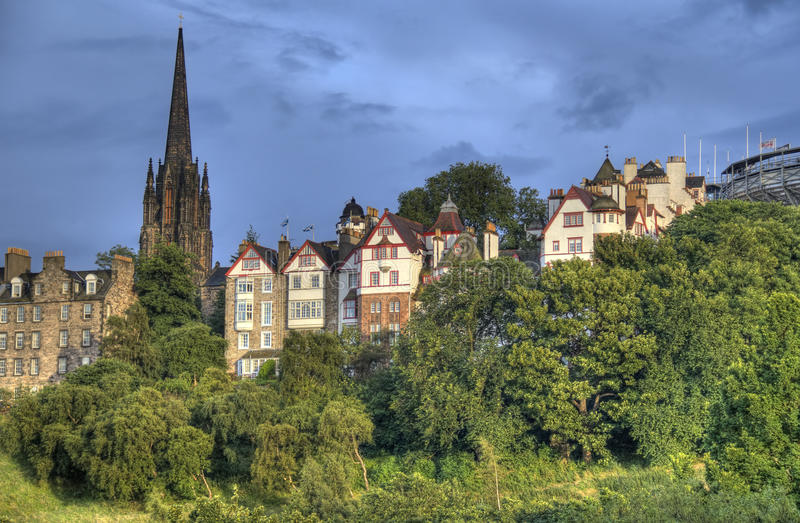 Edinburgh Old City. View of Edinburgh old city with the tower of the Parish Church of Saint Cuthbert above the trees of Princes Street Gardens royalty free stock images