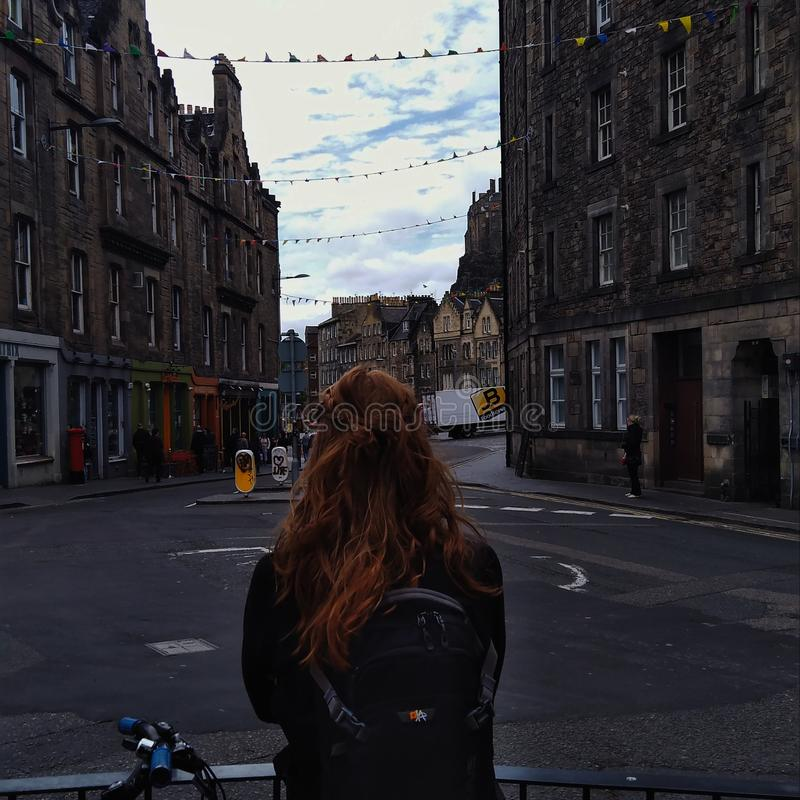Edinburgh old town, an Irish girl looking out into the streets stock images