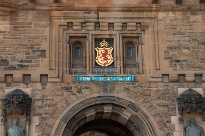 The interior walls of Edinburgh Catle. Edinburgh, Scotland - April, 17, 2019: interior view the old castle walls, gate and royal insignia stock photo