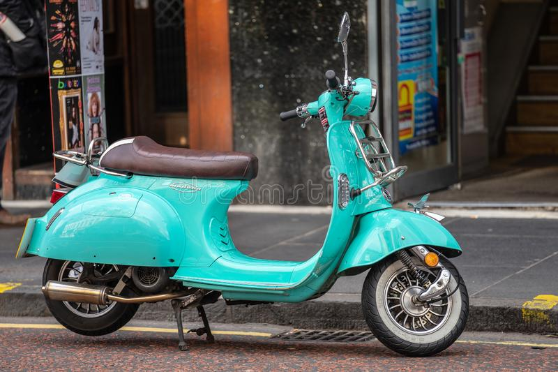 Edinburgh, Scotland, August 8th 2019. Bright aqua blue motor scooter parked on the street stock images