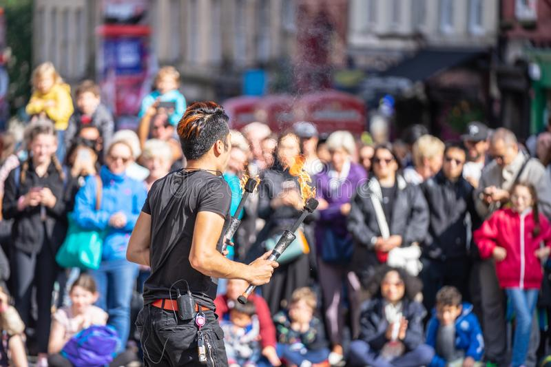 Edinburgh, Scotland, August 8th 2019. Fire performance includes skills based on juggling, baton twirling, poi spinning, and other. Forms of object manipulation stock photography