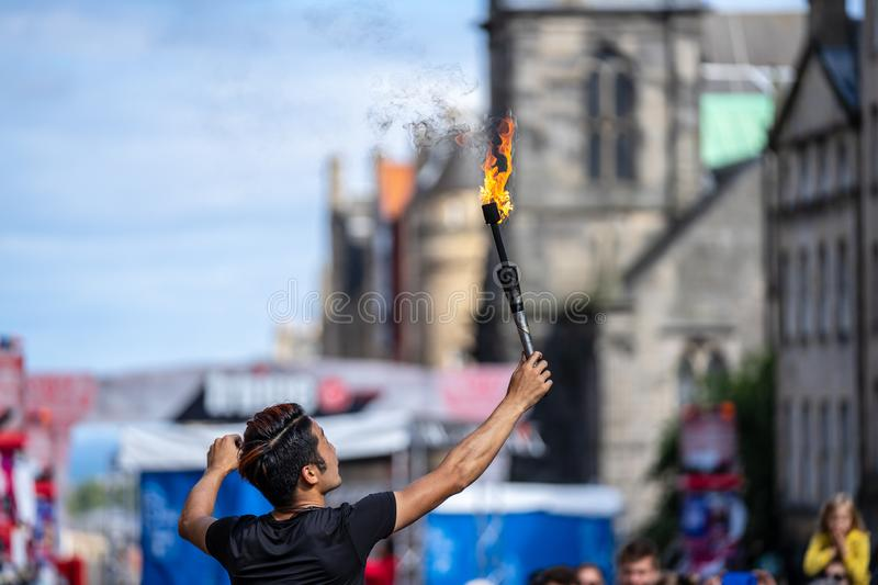 Edinburgh, Scotland, August 8th 2019. Fire performance includes skills based on juggling, baton twirling, poi spinning, and other. Forms of object manipulation stock image