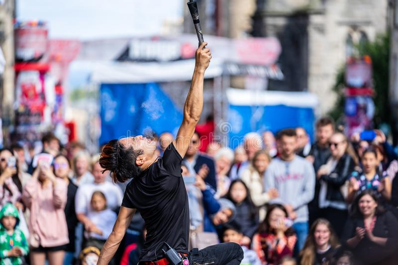 Edinburgh, Scotland, August 8th 2019. Fire performance includes skills based on juggling, baton twirling, poi spinning, and other. Forms of object manipulation royalty free stock photo