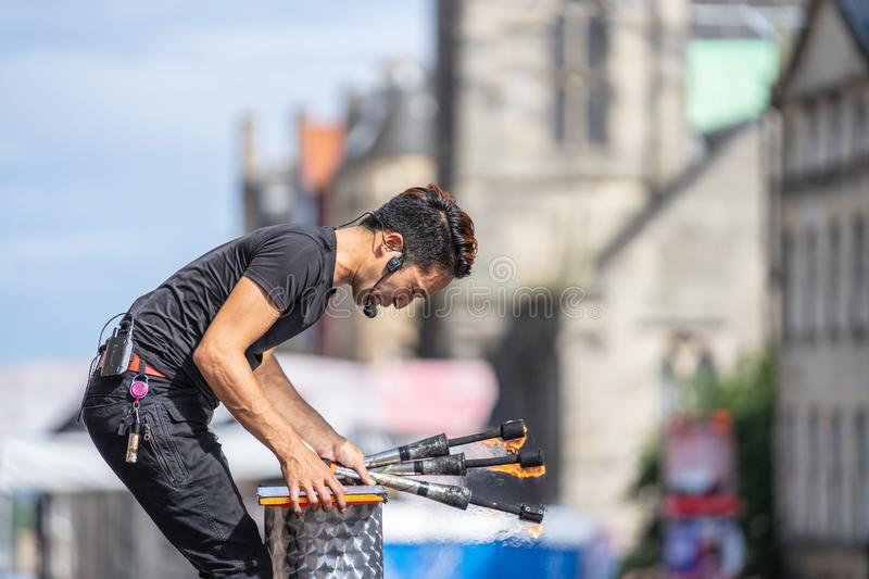 Edinburgh, Scotland, August 8th 2019. Fire performance includes skills based on juggling, baton twirling, poi spinning, and other. Forms of object manipulation royalty free stock image
