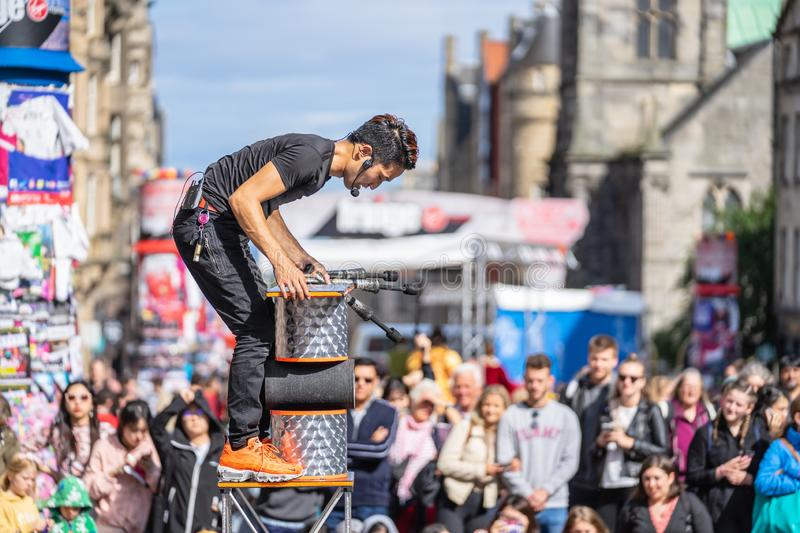 Edinburgh, Scotland, August 8th 2019. Fire performance includes skills based on juggling, baton twirling, poi spinning, and other. Forms of object manipulation stock images