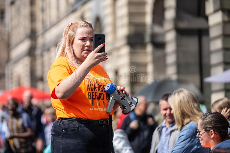 Edinburgh, Scotland, August 8th 2019. Leaflet Distributors or Flyer Distributors.The Edinburgh Festival Fringe, also referred to. As The Fringe or Edinburgh royalty free stock images