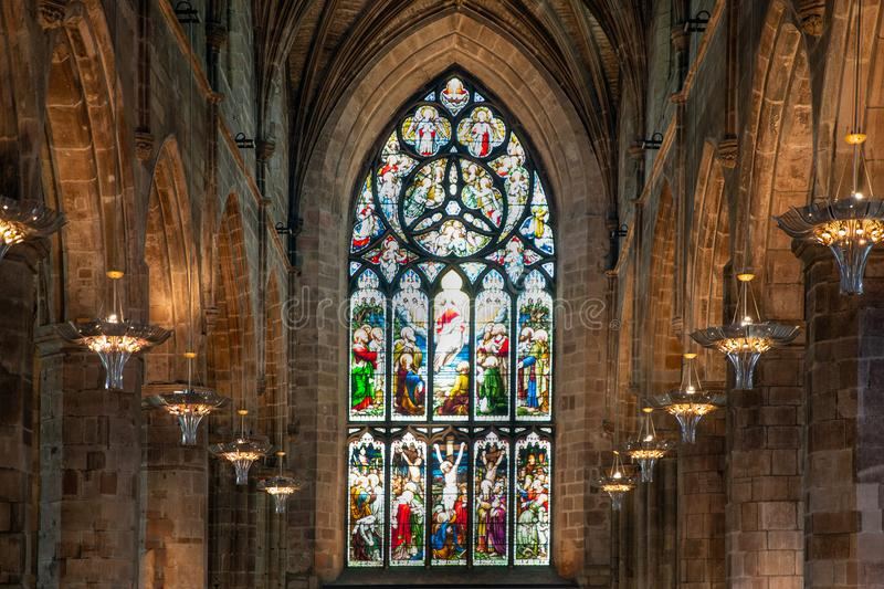 Interior St. Giles Cathedral in Edinburgh with stained glass window stock images