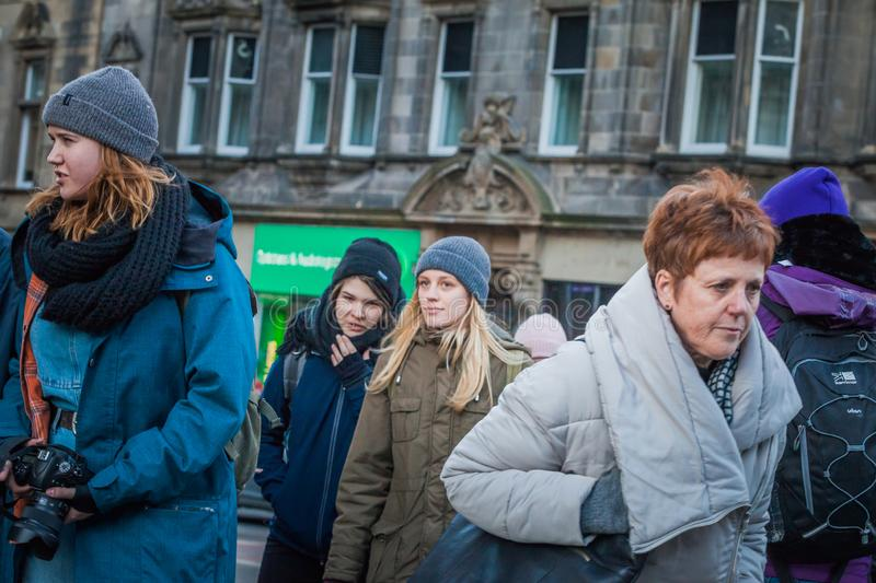 Street scene in Edinburgh, with young tourists walking royalty free stock image