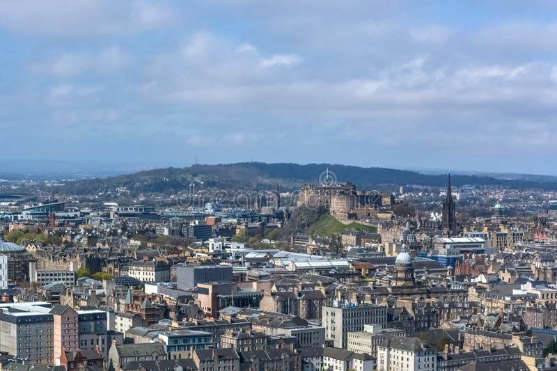 General aerial view from the Holyrood Park to the Edinburgh downtown city, monument buildings, mountains and parks on background. Edinburgh / Scotland / UK - 04/ royalty free stock image