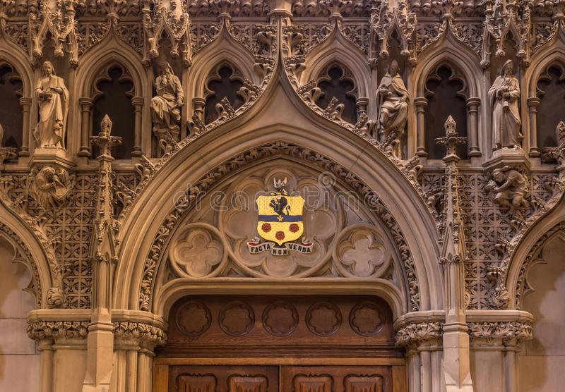 Monumental door at St Giles Cathedral, Edinburgh, Scotland, UK. Edinburgh, Scotland, UK - June 13, 2012; St Giles Cathedral. Monumental deacorated door gate royalty free stock photography