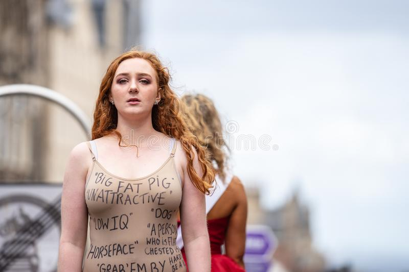 Edinburgh, Scotland, UK. 18th August, 2019. A performer on The Royal Mile promoting the show Beauty Is Pain at Paradise In The. Vault venue 29 during the stock image