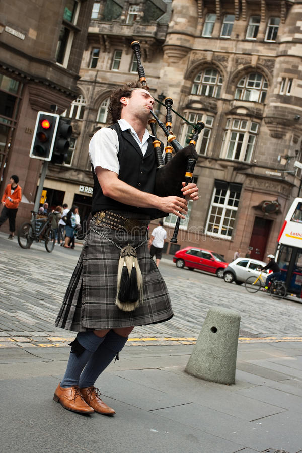 Download Edinburgh street bagpiper editorial stock photo. Image of player - 20193748