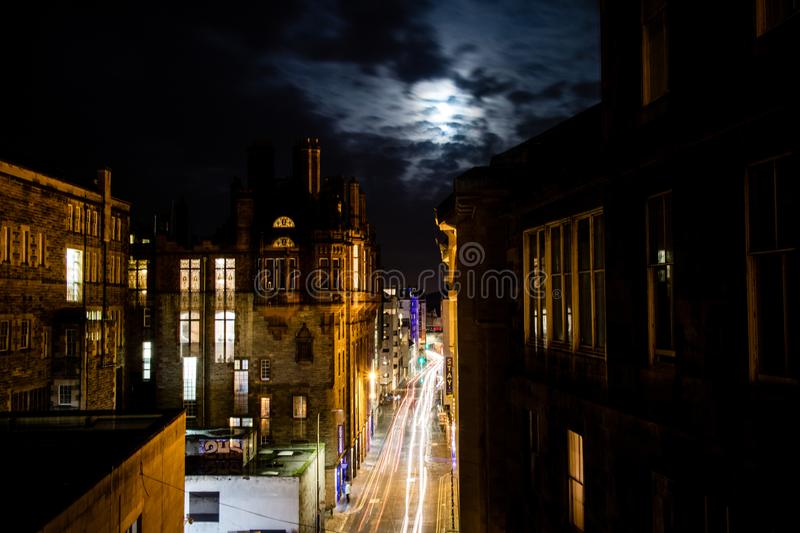 Edinburgh, United Kingdom - 12/04/2017: A night view of light tr. Ails on a road that cuts through Edingurgh at night royalty free stock image