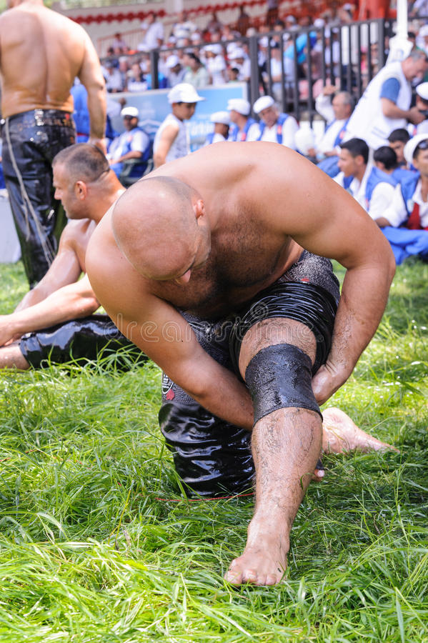 EDIRNE, TURKEY - JULY 06, 2013: Wrestler getting ready before competition in traditional Kirkpinar wrestling. Kirkpinar is a Turki. Sh oil-wrestling (Turkish stock images