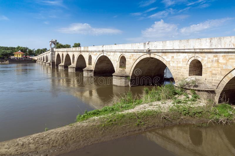 Medieval Bridge from period of Ottoman Empire over Meric River in city of Edirne, East Thrace, Tur. EDIRNE, TURKEY - MAY 26, 2018: Medieval Bridge from period of royalty free stock photo