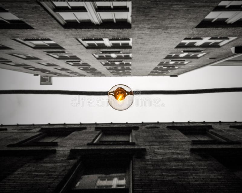Edison bulb strung between two downtown buildings in Atlanta royalty free stock image
