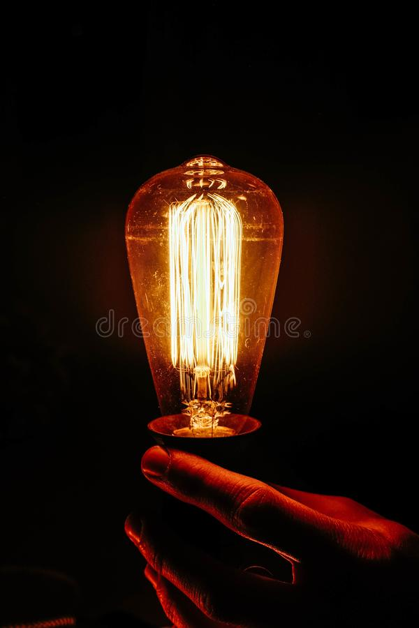Edison light bulbs in hand. Electricity yellow light from Edison bulbs. Creative ideas. Electricity equipment royalty free stock photo