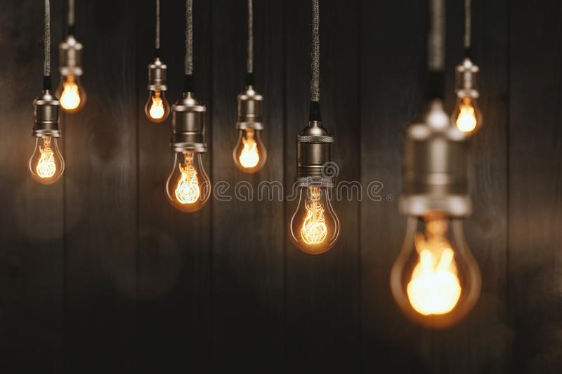 Edison light bulbs in front of a wooden wall. Edison light bulbs technology electronic lighting stock photography