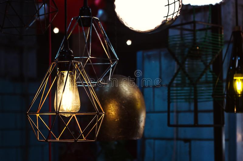 Edison`s light bulb and lamp in modern style. Warm tone light bulb lamp, loft lamps, vintage, retro style. Lamps in coffee shop. E stock image