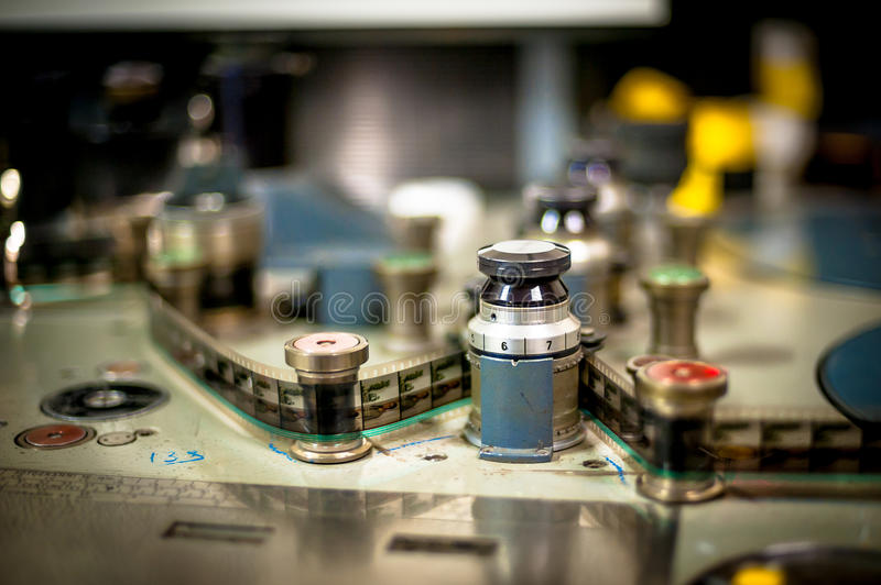Editing machine for 35 mm movie detail. Spool and film selective focus vintage color effect stock photo