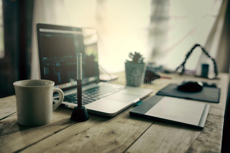 Editor desk for working editing video in office supplies laptop. And coffee cup paste on wooden table stock photos