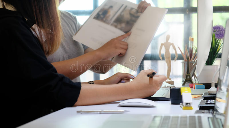 Editor talking a plan for magazine edit team of creative. royalty free stock photo