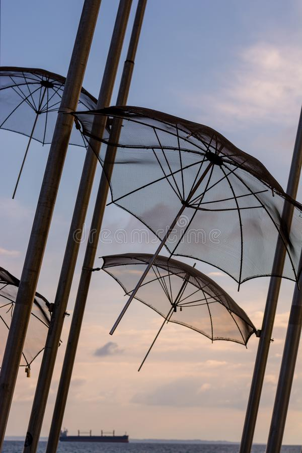 Editorial. April 2019. THESSALONIKI, GREECE. The installation of umbrellas in Thessaloniki is a symbol of the city. Installation of umbrellas in the sky stock photos
