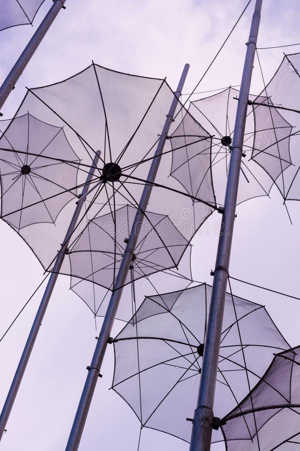 Editorial. April 2019. THESSALONIKI, GREECE. The installation of umbrellas in Thessaloniki is a symbol of the city. Installation of umbrellas in the sky stock photography