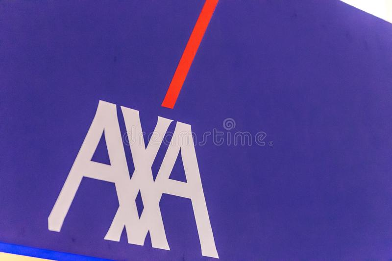 EDITORIAL, AXA. LUGO RA, ITALY – SEPTEMBER 11, 2018: Dust and dirt covering the AXA logo on signboard royalty free stock images