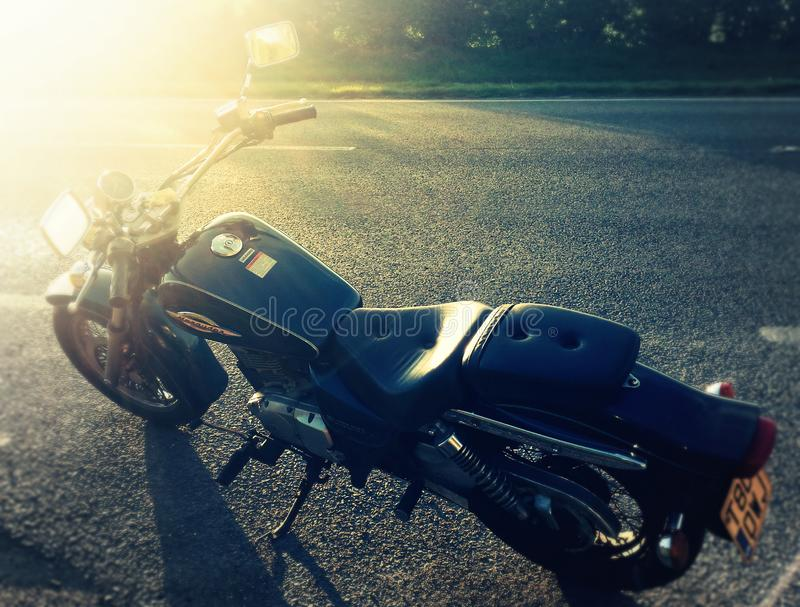 Editorial da motocicleta do saqueador gz125 de Suzuki fotografia de stock