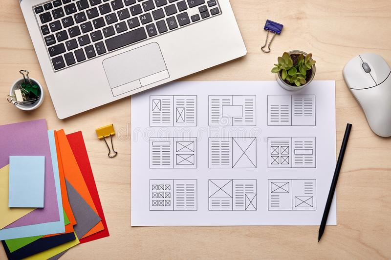 Editorial designer desk with publication layout stock image