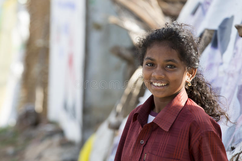 Editorial illustrative image. Poor kid smiling, India. Illustrative image. Pondicherry, Tamil Nadu, India - Marsh 07, 2014. Poor child with smile feeling, in the stock photos