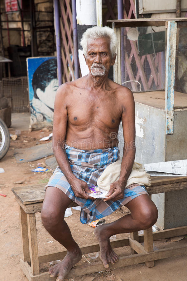 Editorial illustrative image. Portrait of smiling sad senior Indian man. Illustrative image. Pondicherry, Tamil Nadu, India - April 14, 2014. Portrait of senior stock image