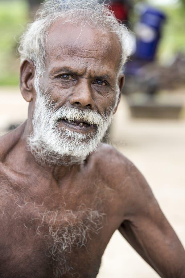 Editorial illustrative image. Portrait of smiling sad senior Indian man. Illustrative image. Pondicherry, Tamil Nadu, India - April 14, 2014. Portrait of senior stock images